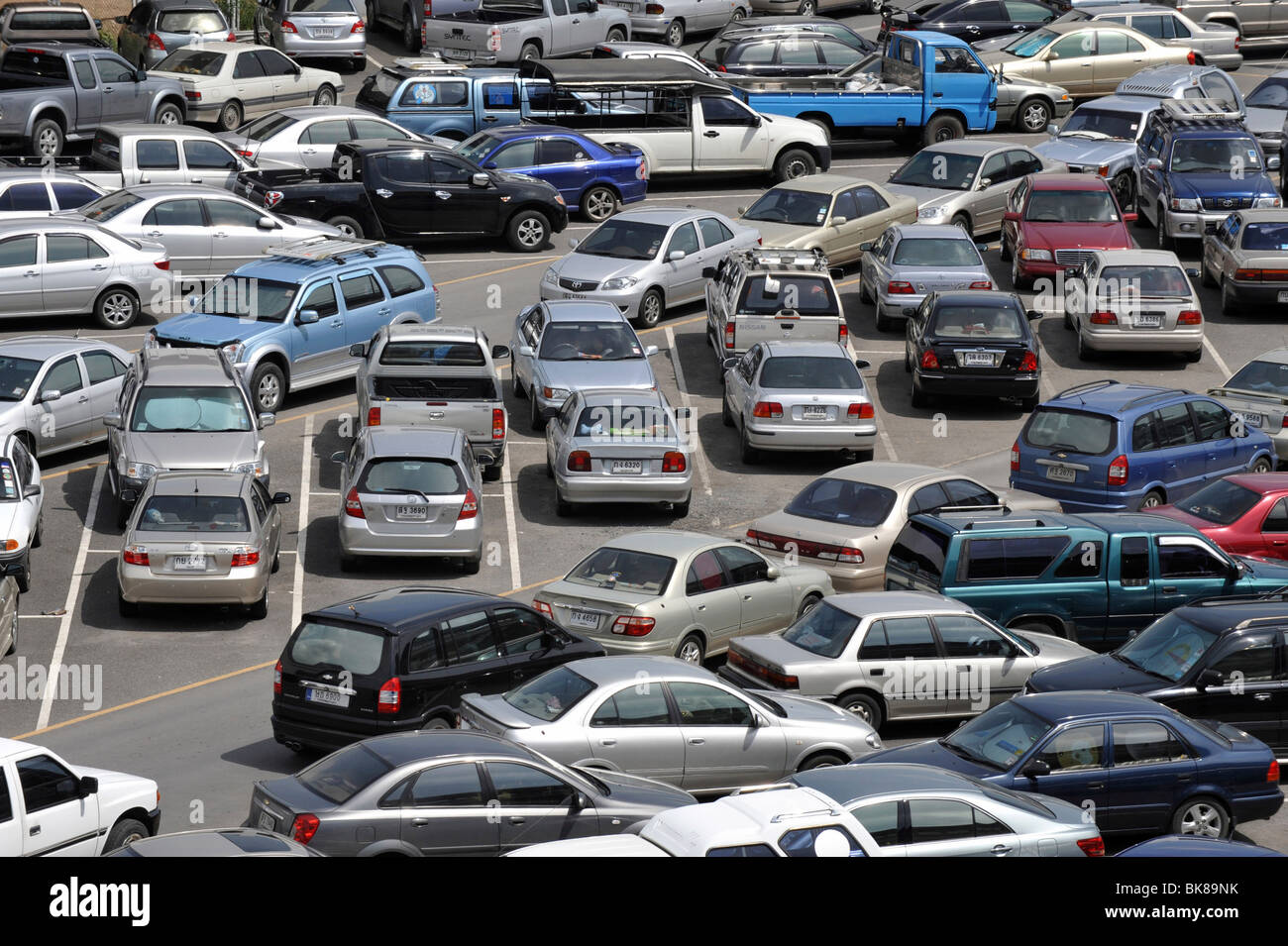 Parked cars in a parking lot in Bangkok, Thailand, Asia - Stock Image