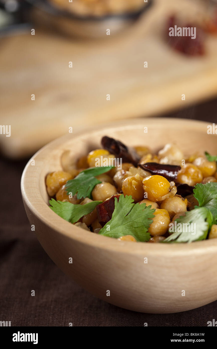 Bowl of Indian starter with chickpeas and cilantro - Stock Image