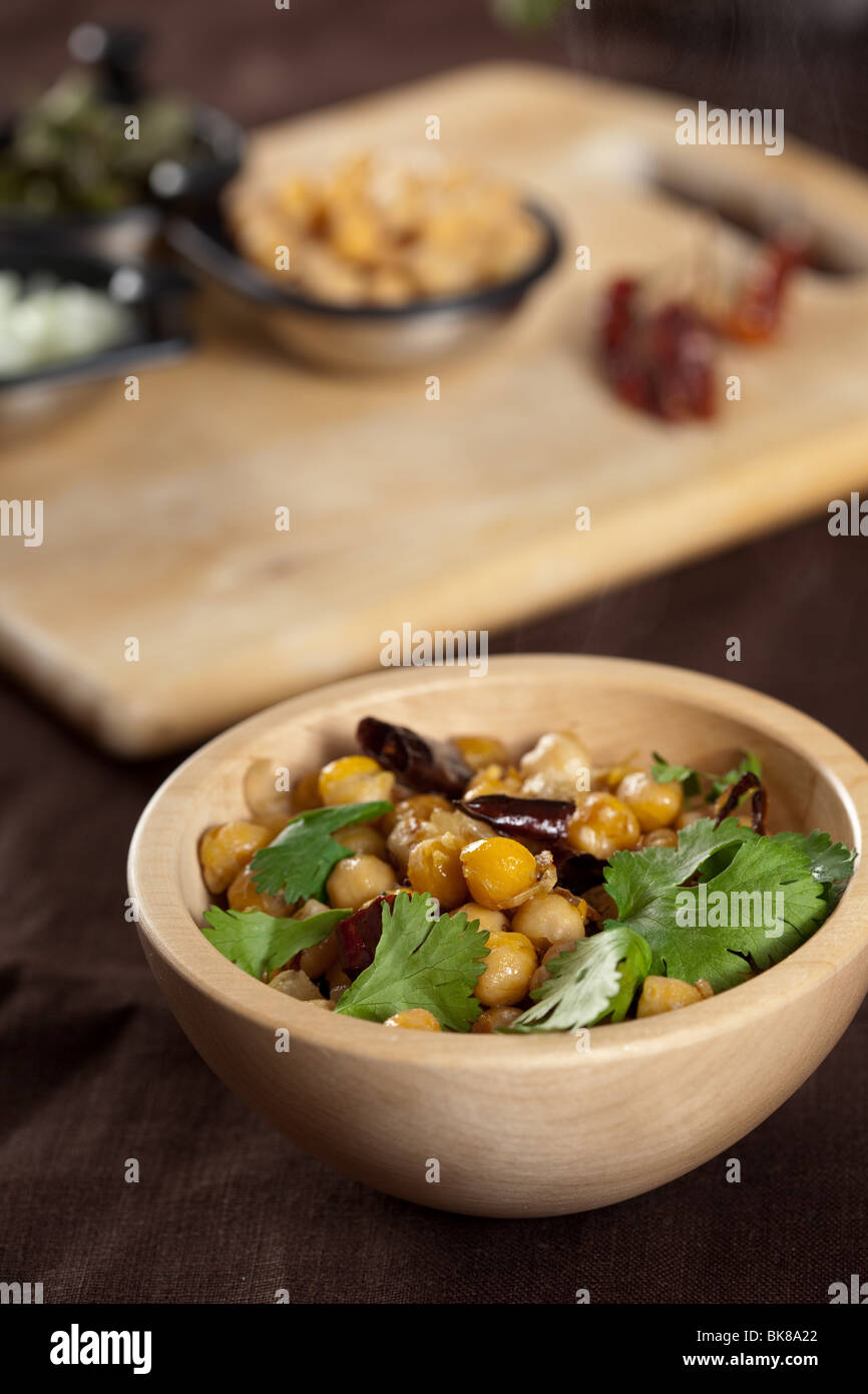 Delicious freshly made Indian starter with chickpeas and cilantro - Stock Image