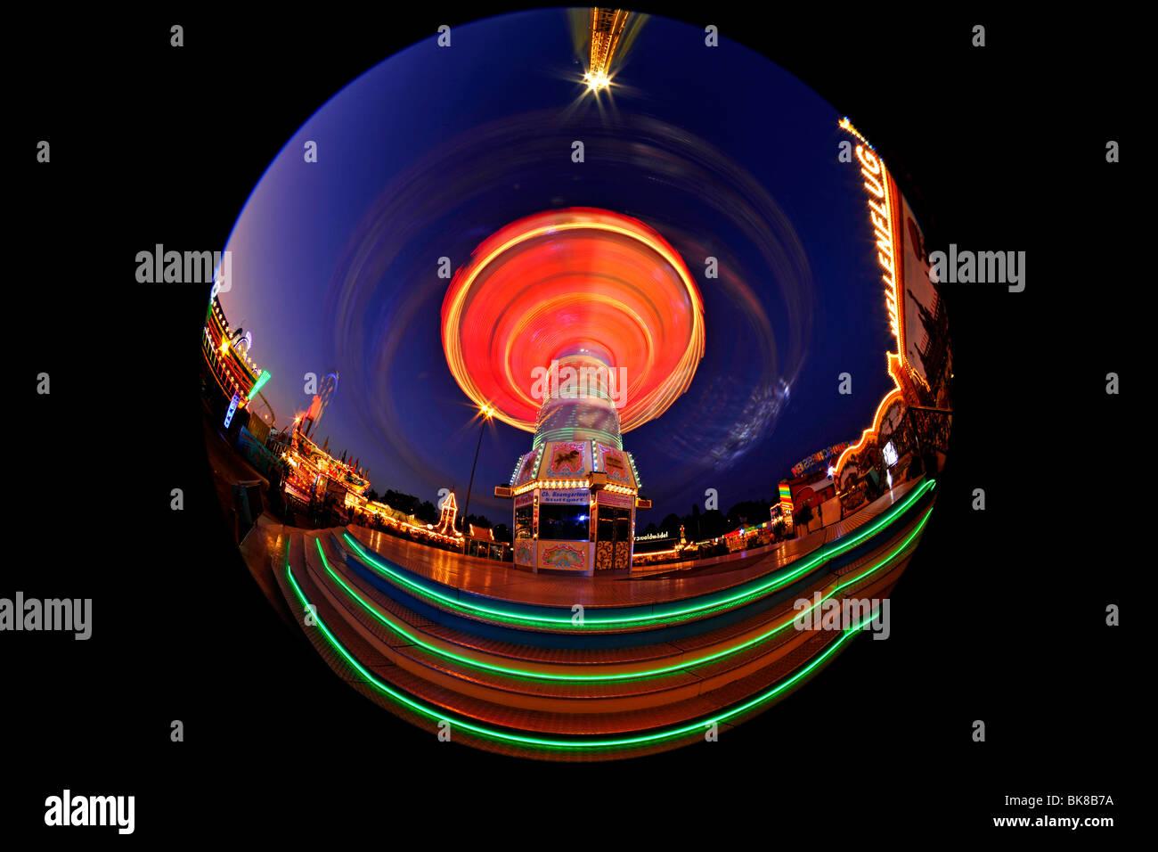 Night scene, fisheye shot, Chair-O-Planes or Swing Carousel, Cannstatt Festival, Stuttgart Beer Festival, Stuttgart, Stock Photo