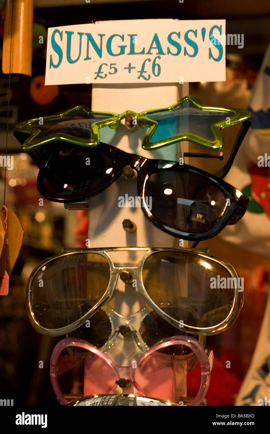 Comical sunglasses for sale at a London street market. - Stock Image