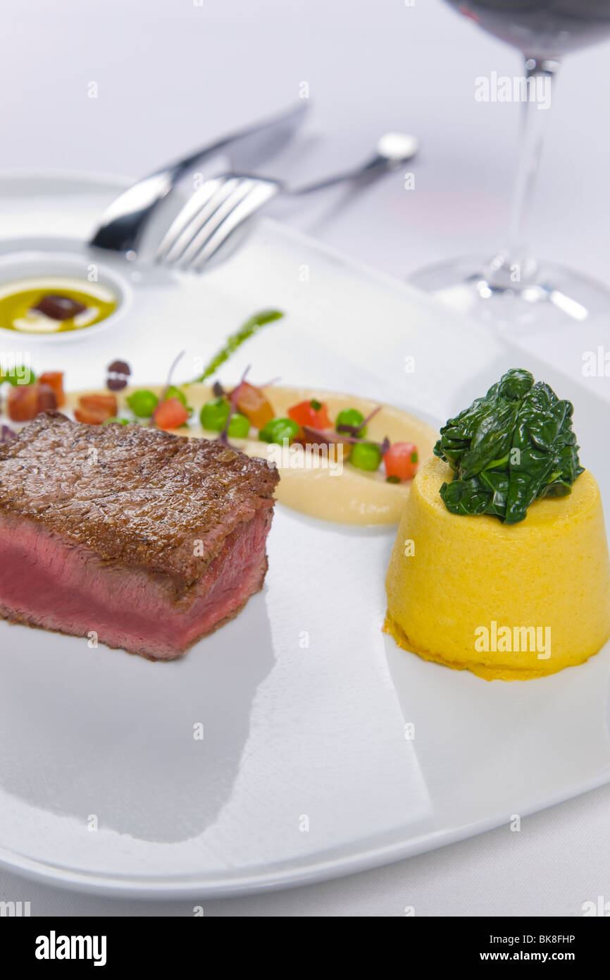Steak served with condiments Stock Photo