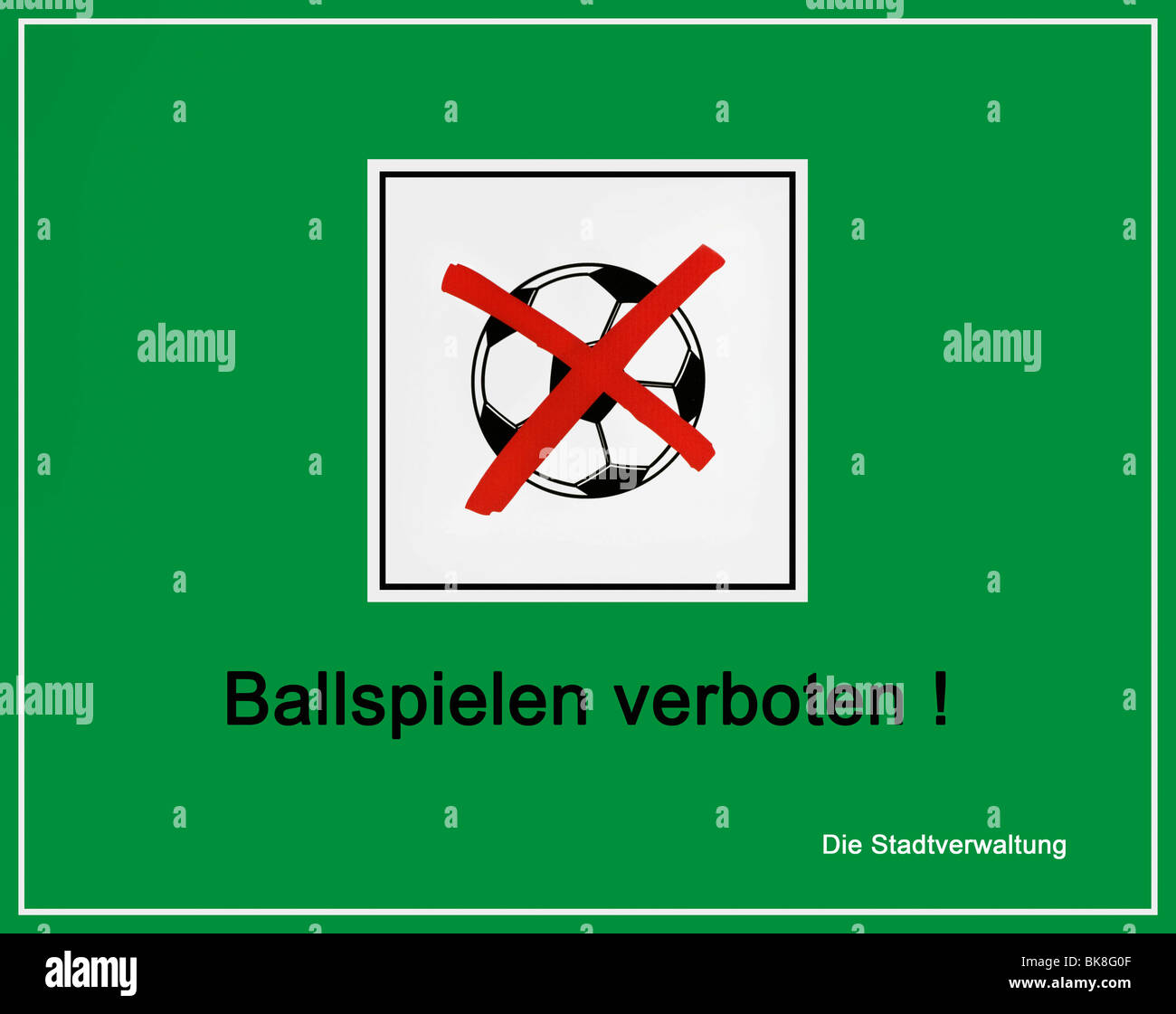 Green sign, information board, crossed out football, 'Ball games prohibited! Municipality' - Stock Image