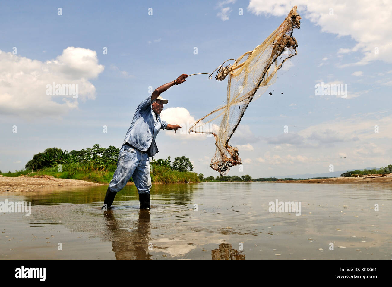 Fisherman tossing a net into the Rio Magdalena River, La Dorada, Caldas, Colombia, South America Stock Photo