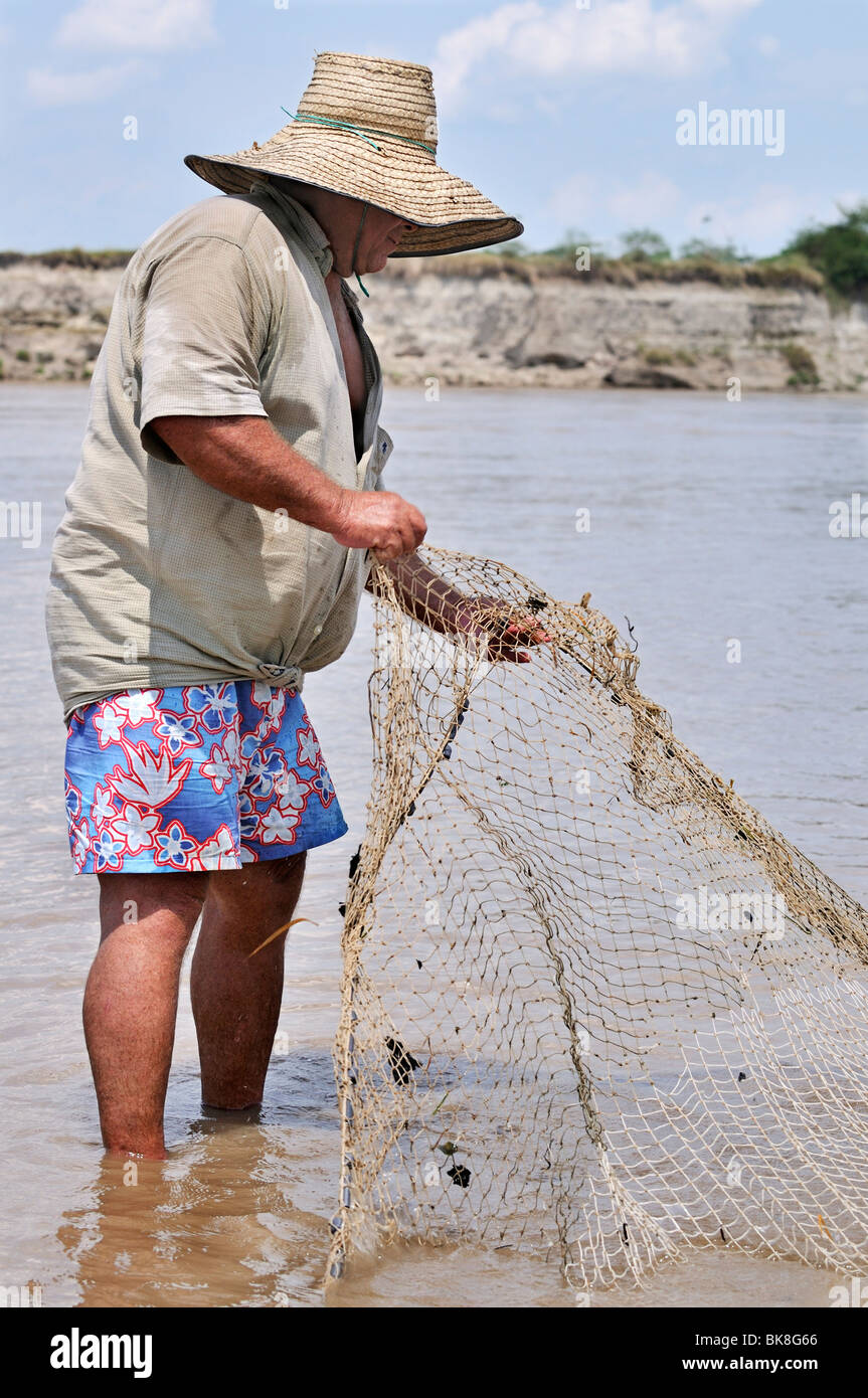 Fisherman holding a net on the Rio Magdalena River, La Dorada, Caldas, Colombia, South America - Stock Image