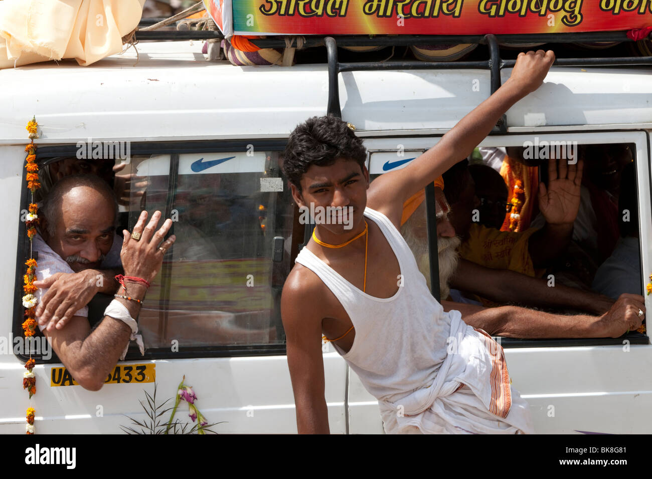 Flowers & traditions accompany Nike symbols and a relatively late model 4WD fillled with sadhus and VIP's - Stock Image