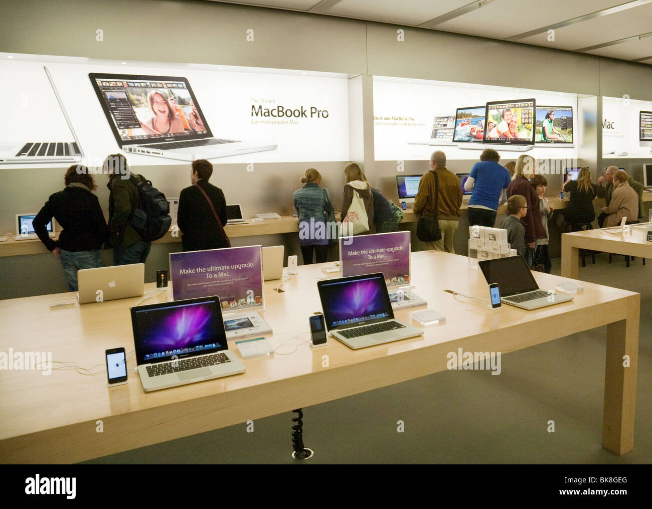 People in an Apple Store, The Grand Arcade, Cambridge UK Stock Photo