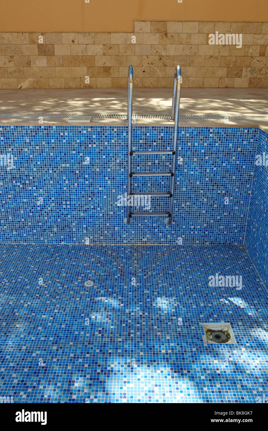 Blue tiled empty swimming pool on a sunny day without water Stock ...