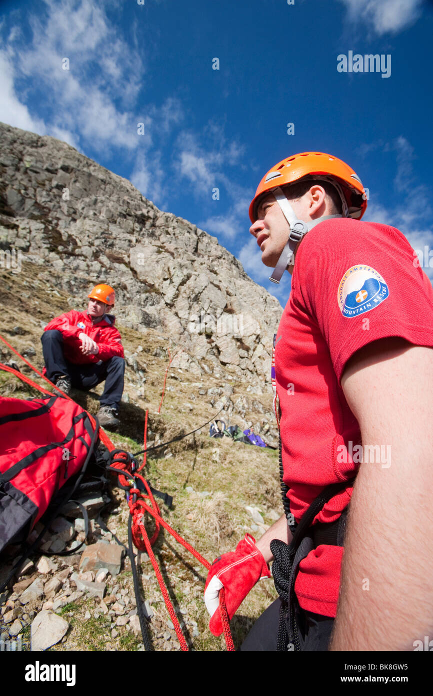 Members of Langdale/Ambleside Mountain Rescue set up a belay into Dungeon Ghyll, to rescue injured stranded walkers. - Stock Image