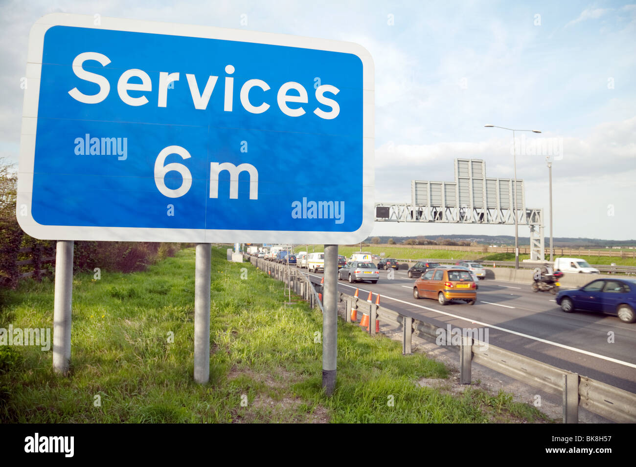motorway services sign by the side of the M25 three miles south of the Dartford Crossing, Kent, UK - Stock Image