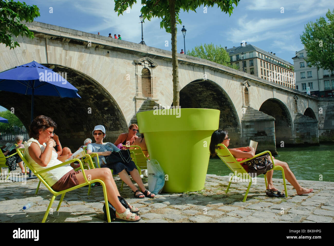 People Enjoying 'Paris Plages' Urban Beach on River Seine plage, Paris France, Summer Festivals, adult extracurricular - Stock Image