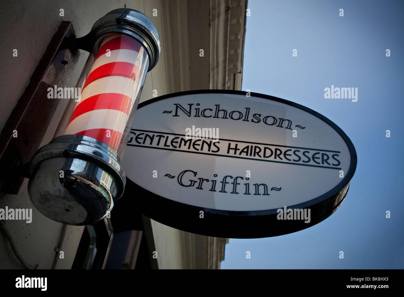 Barber's pole outside gentleman's hairdresser in London, UK - Stock Image