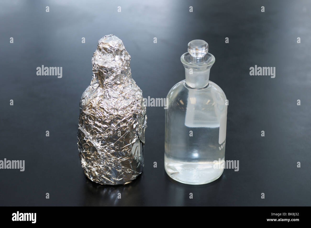 Light/dark bottles for an aquatic primary productivity study. The dissolved oxygen, D.O., of the bottles will being - Stock Image