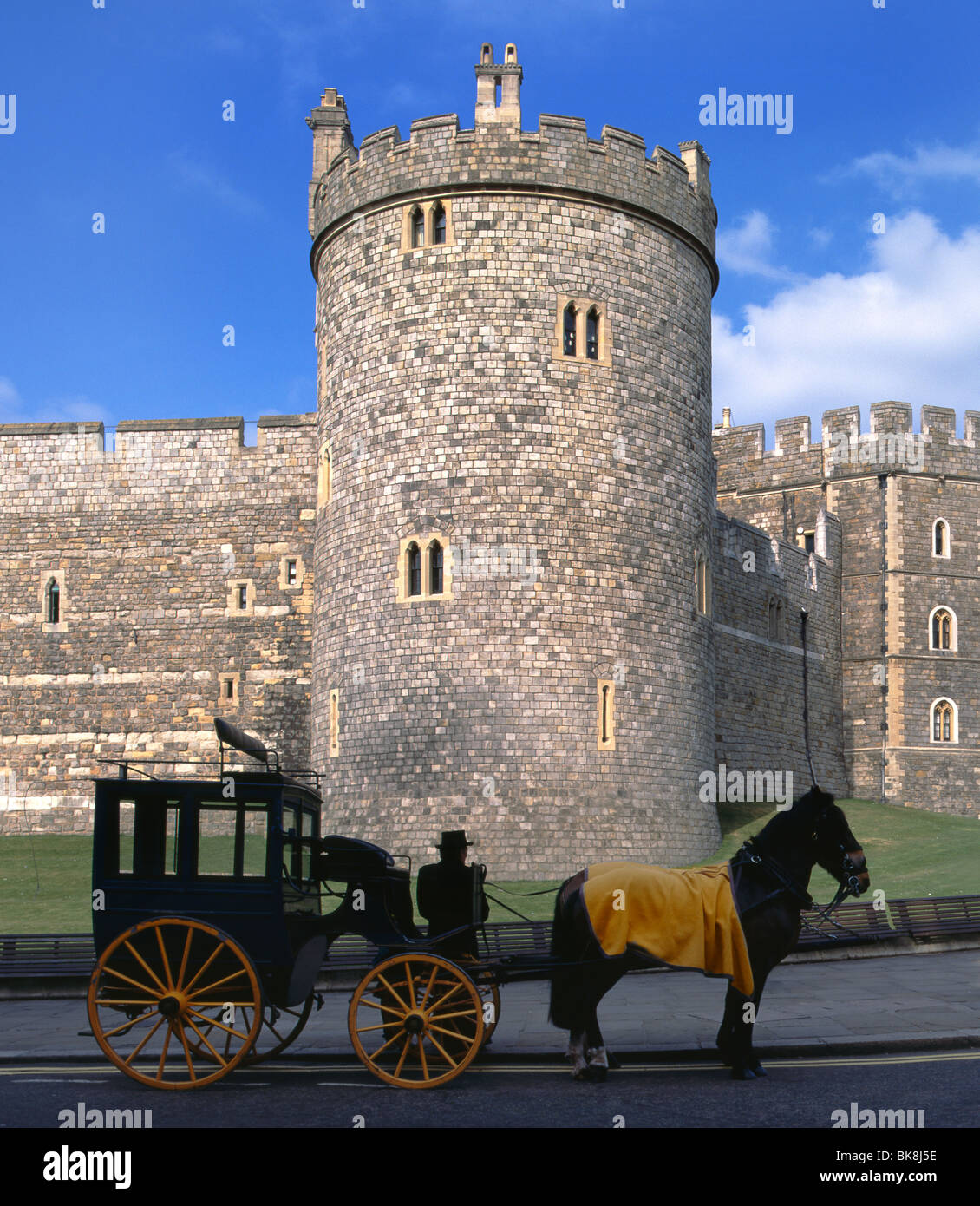 Brougham horse drawn carriage in use as a tourist experience taxi tour waiting outside Windsor Castle Windsor Berkshire - Stock Image