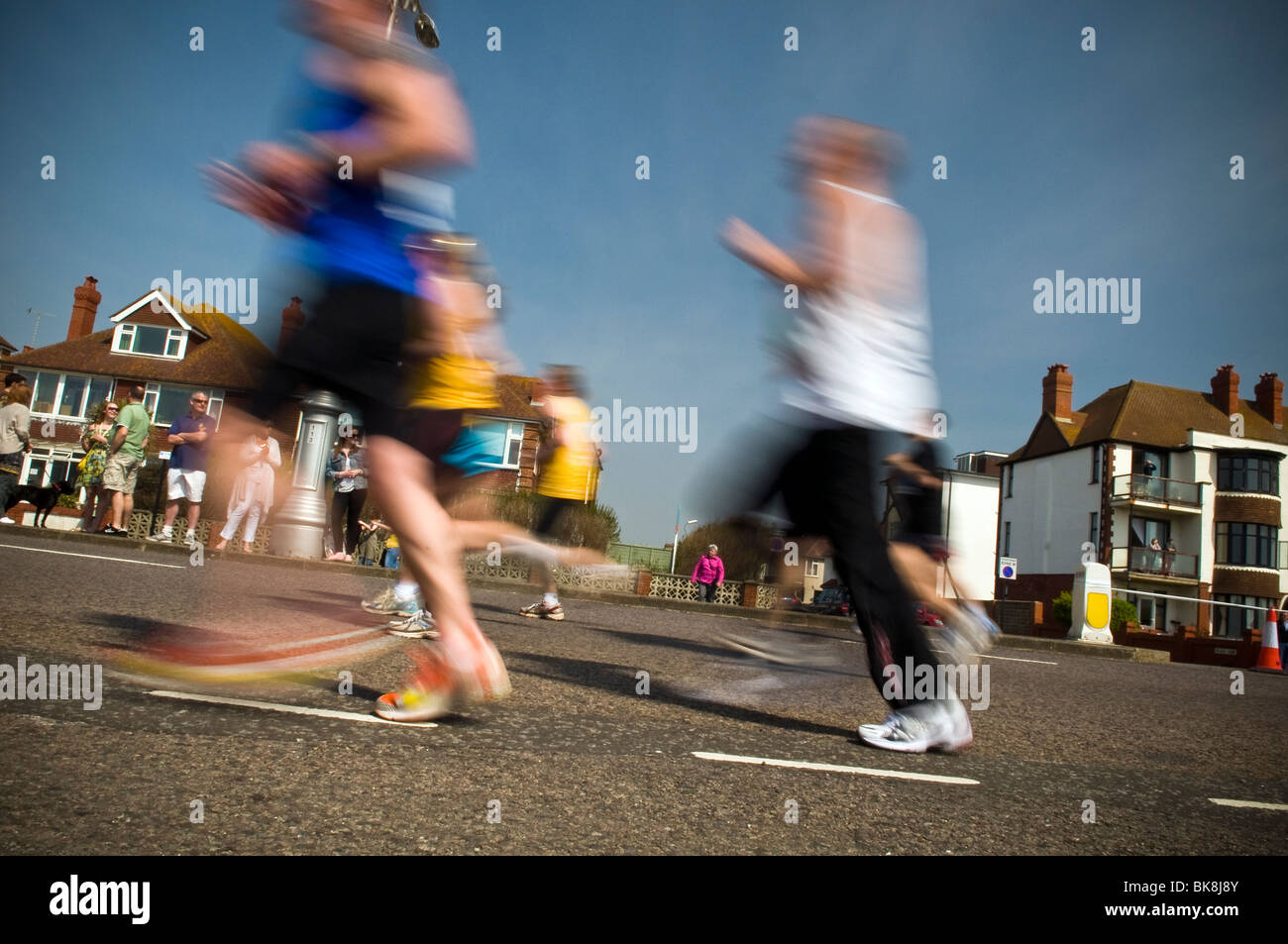 Blurred runners taking part in the first Brighton Marathon April 2010, Hove, East Sussex, UK - Stock Image