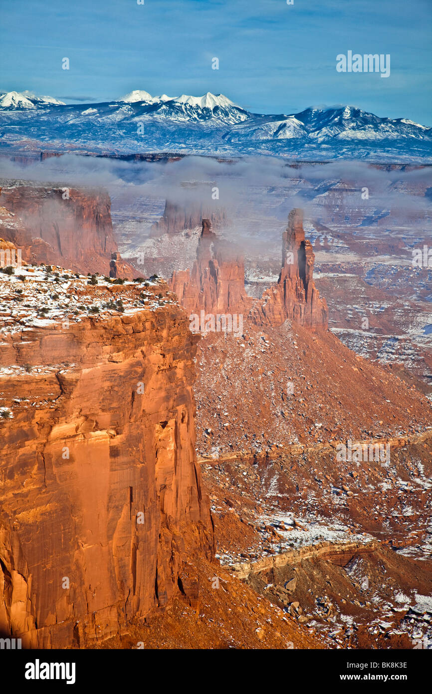 Mist floats over the canyons of Canyonlands National Park, Island in the Sky section, near Moab, Utah. - Stock Image