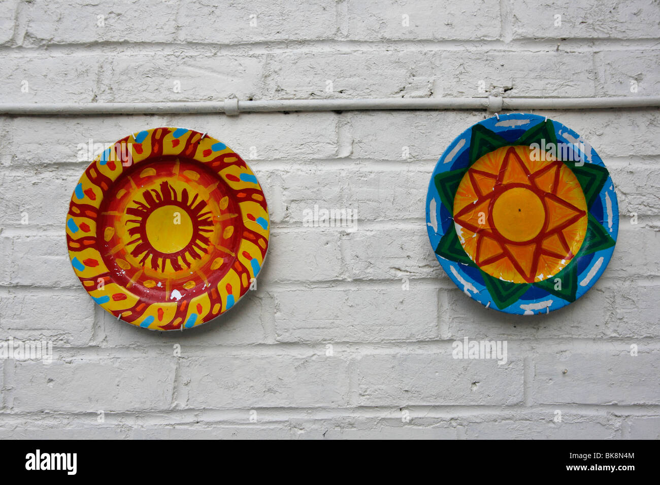 decorate plates hanging on a painted brick garden wall  sc 1 st  Alamy & decorate plates hanging on a painted brick garden wall Stock Photo ...