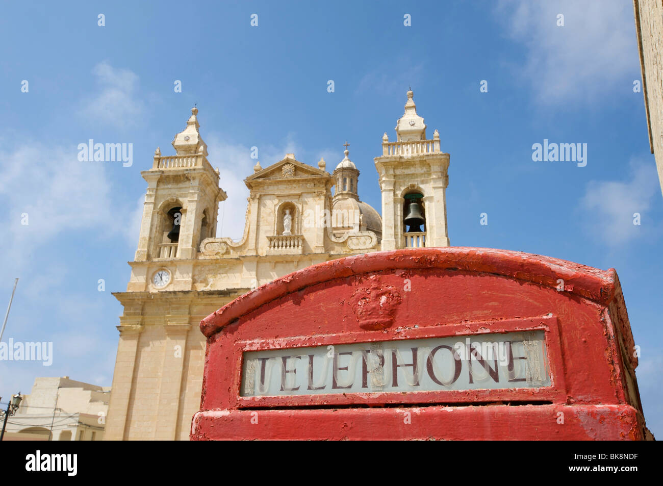 Telephone box and cathedral in Zebbug, Malta, Europe - Stock Image