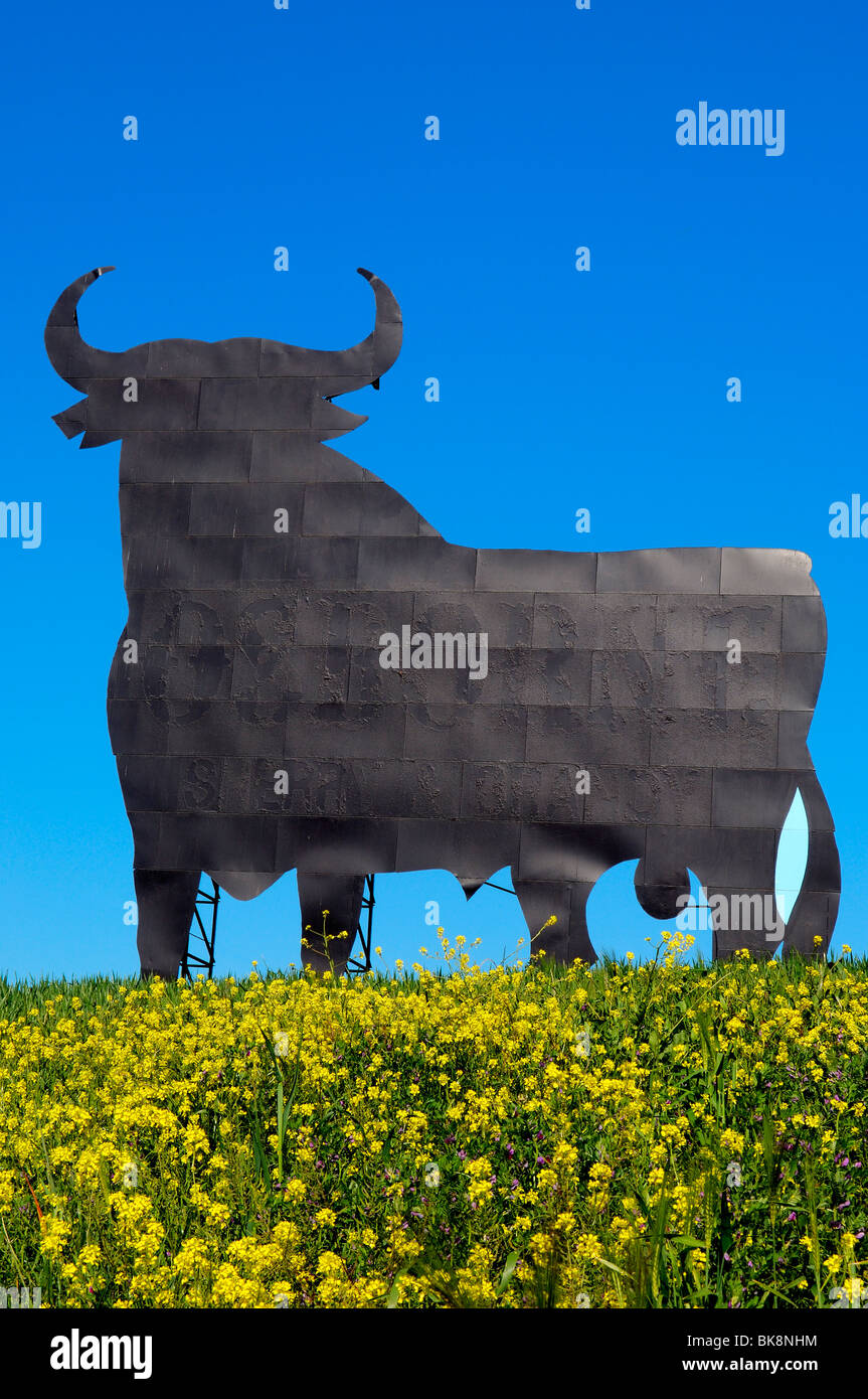 Bull silhouette, typical advertising of Spanish sherry Osborne. Malaga. Andalusia, Spain - Stock Image