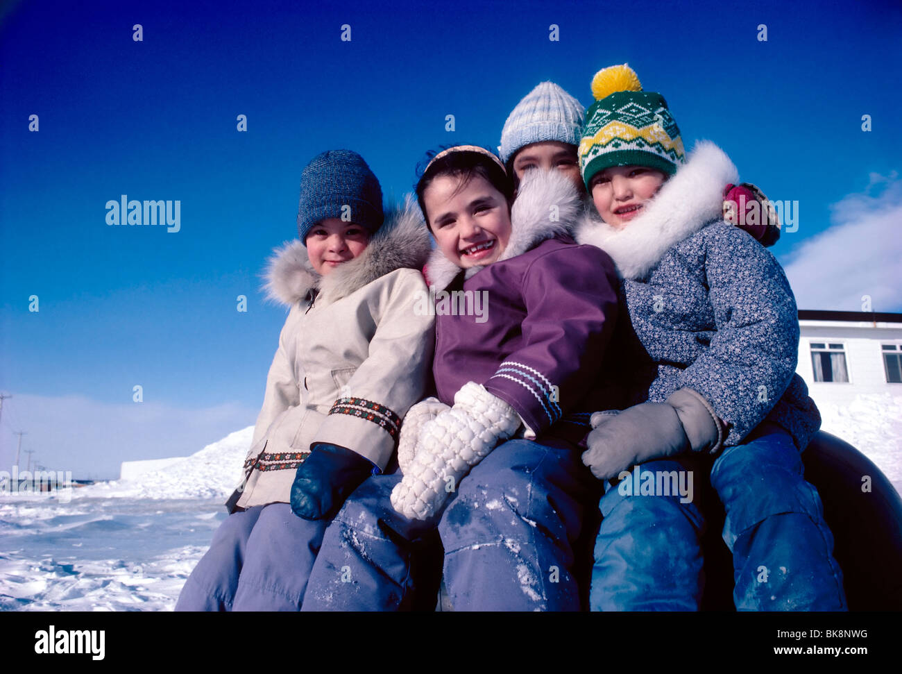 Inuit children pose for a photograph during school recess, Iqaluit, Baffin Island, Nunavut, Canada - Stock Image
