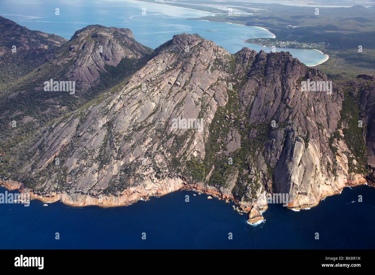 The Hazards, Freycinet National Park, Freycinet Peninsula, Eastern Tasmania, Australia - aerial - Stock Image