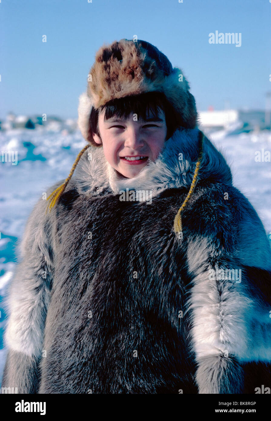 Nigel Boddy, young native boy, dressed in traditional Inuit skin clothing, Iqaluit, Baffin Island, Nunavut, Canada - Stock Image