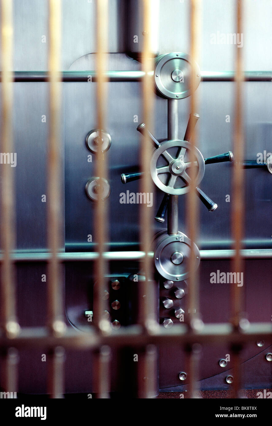 View through steel bars of a bank vault door - Stock Image