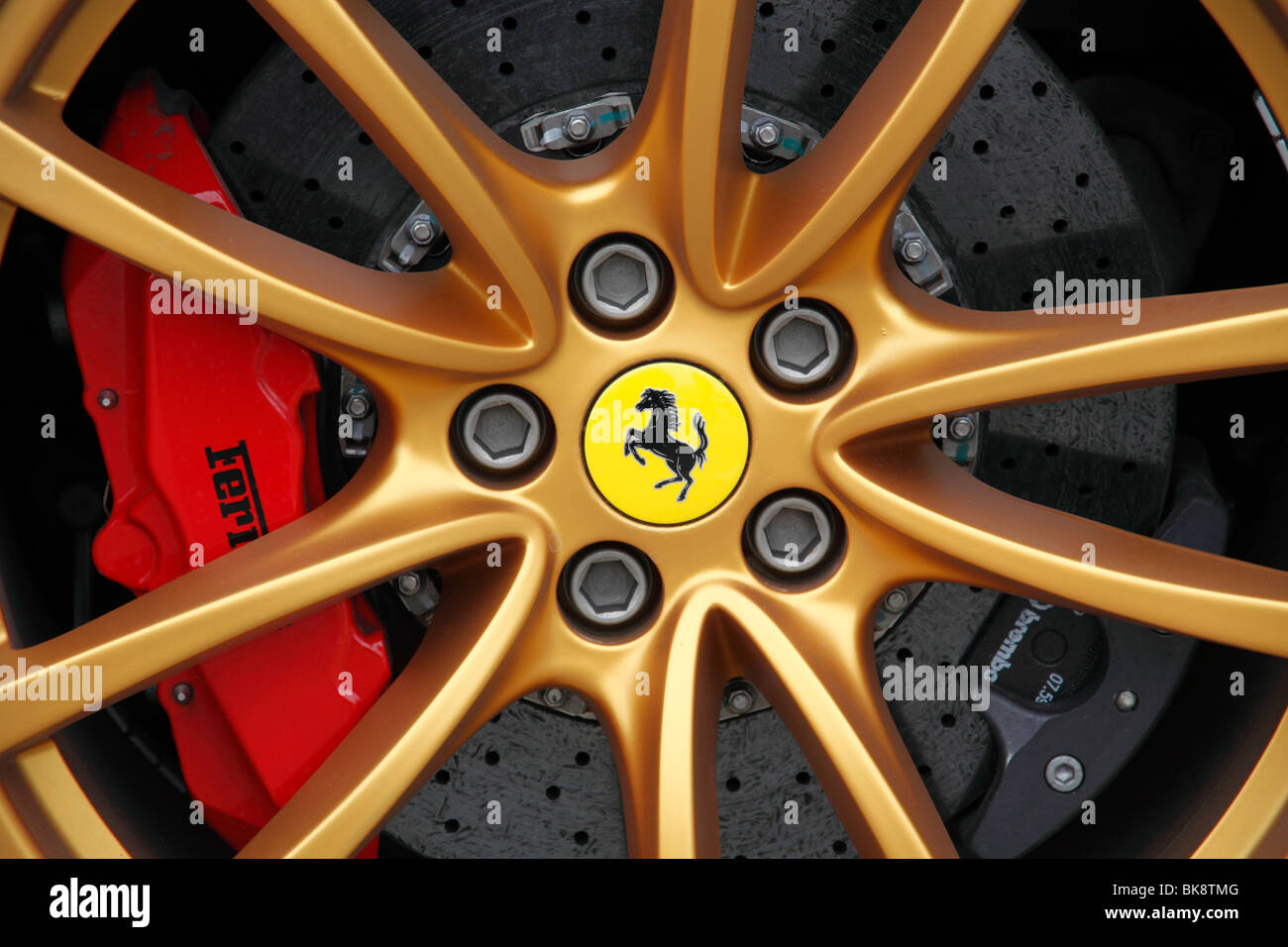 Alloy wheel of a Ferrari car and huge disk brakes by Brembo - Stock Image