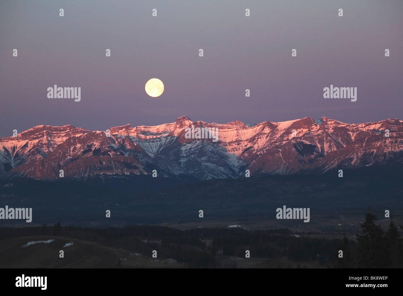 Alberta, Canada; Moon Set Over Front Range Mountains - Stock Image