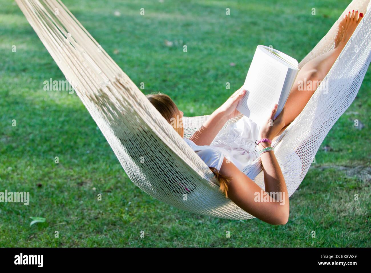 Girl in a hammock - Stock Image