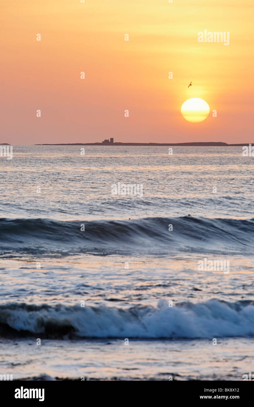The Farne Islands at sunrise. Viewed from Bamburgh, Northumberland, England, UK. Stock Photo