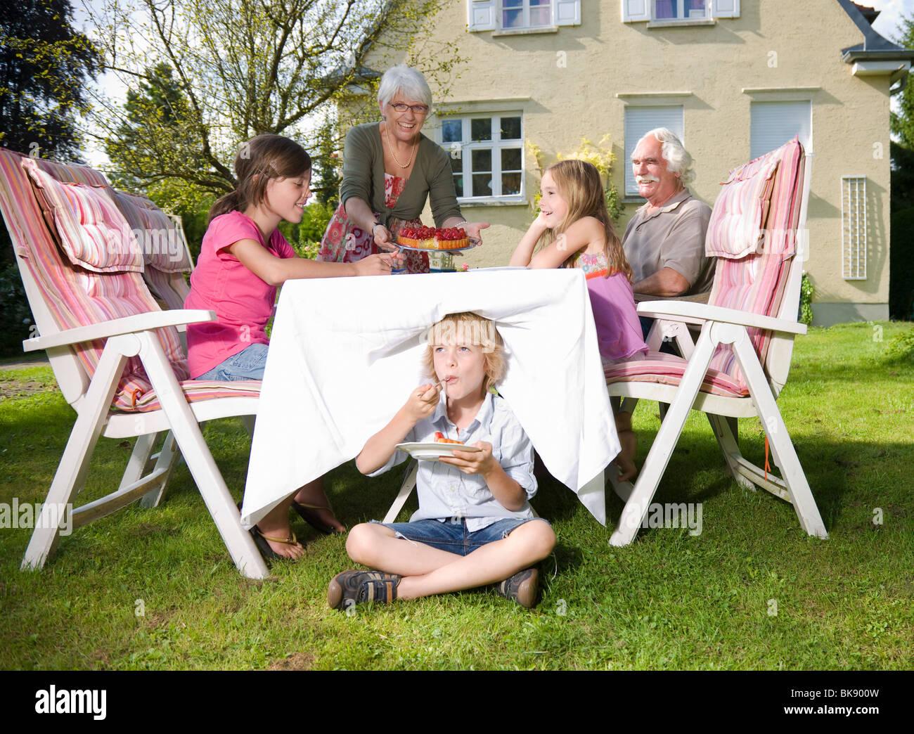 Grandmother serve strawberry pie - Stock Image