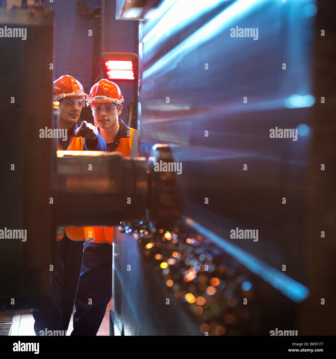 Engineer & Apprentice Using Cutting Tool - Stock Image