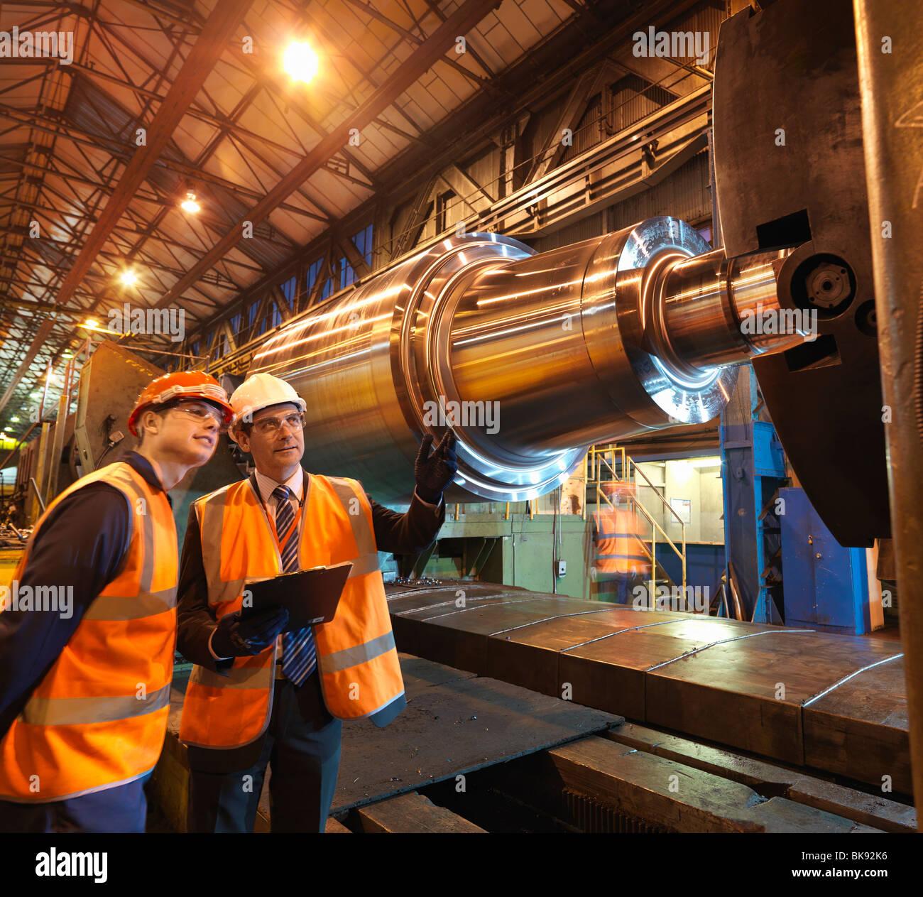 Engineer & Apprentice With Steel Roller Stock Photo