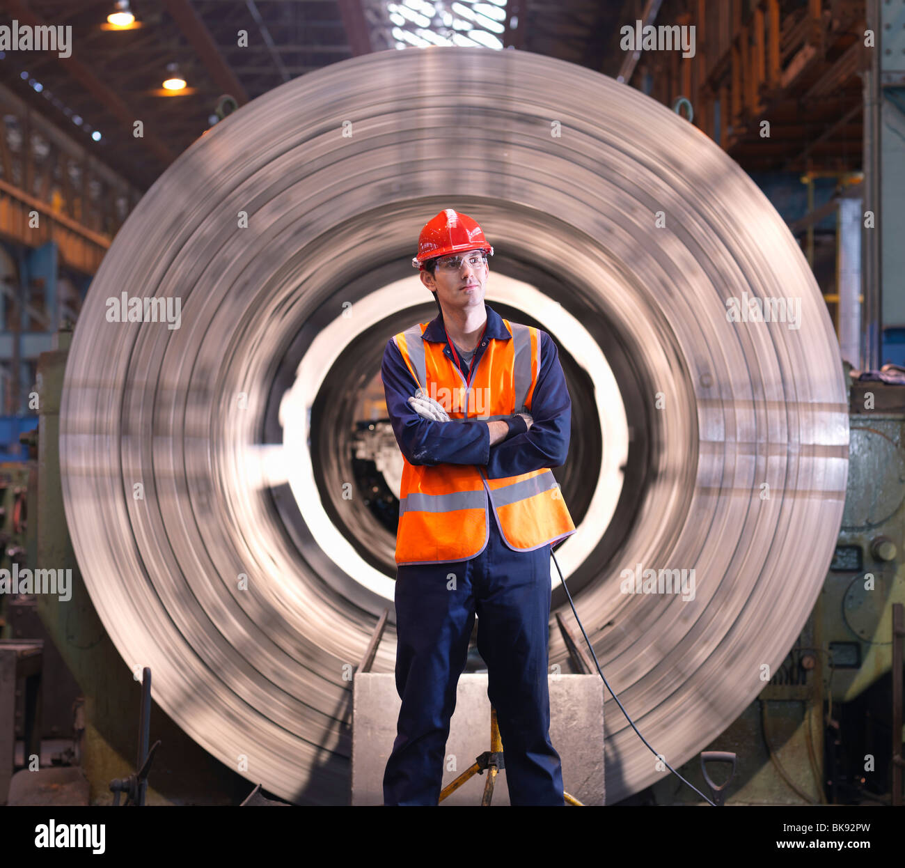 Engineer In Front Of Steel Lathe - Stock Image