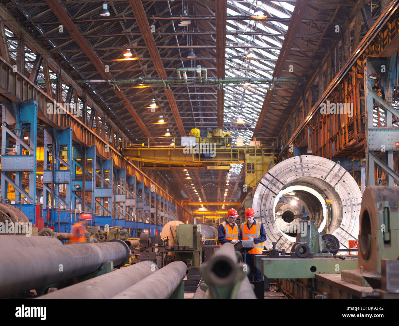 Engineers In Steel Factory With Lathe - Stock Image