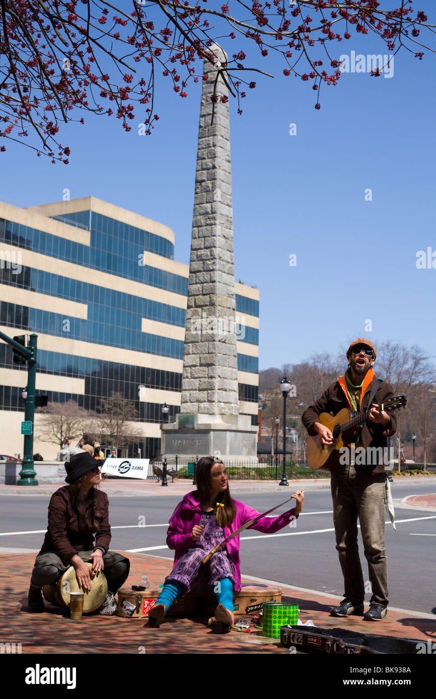 Street musicians playing on Pack Square in Asheville, North Carolina - Stock Image