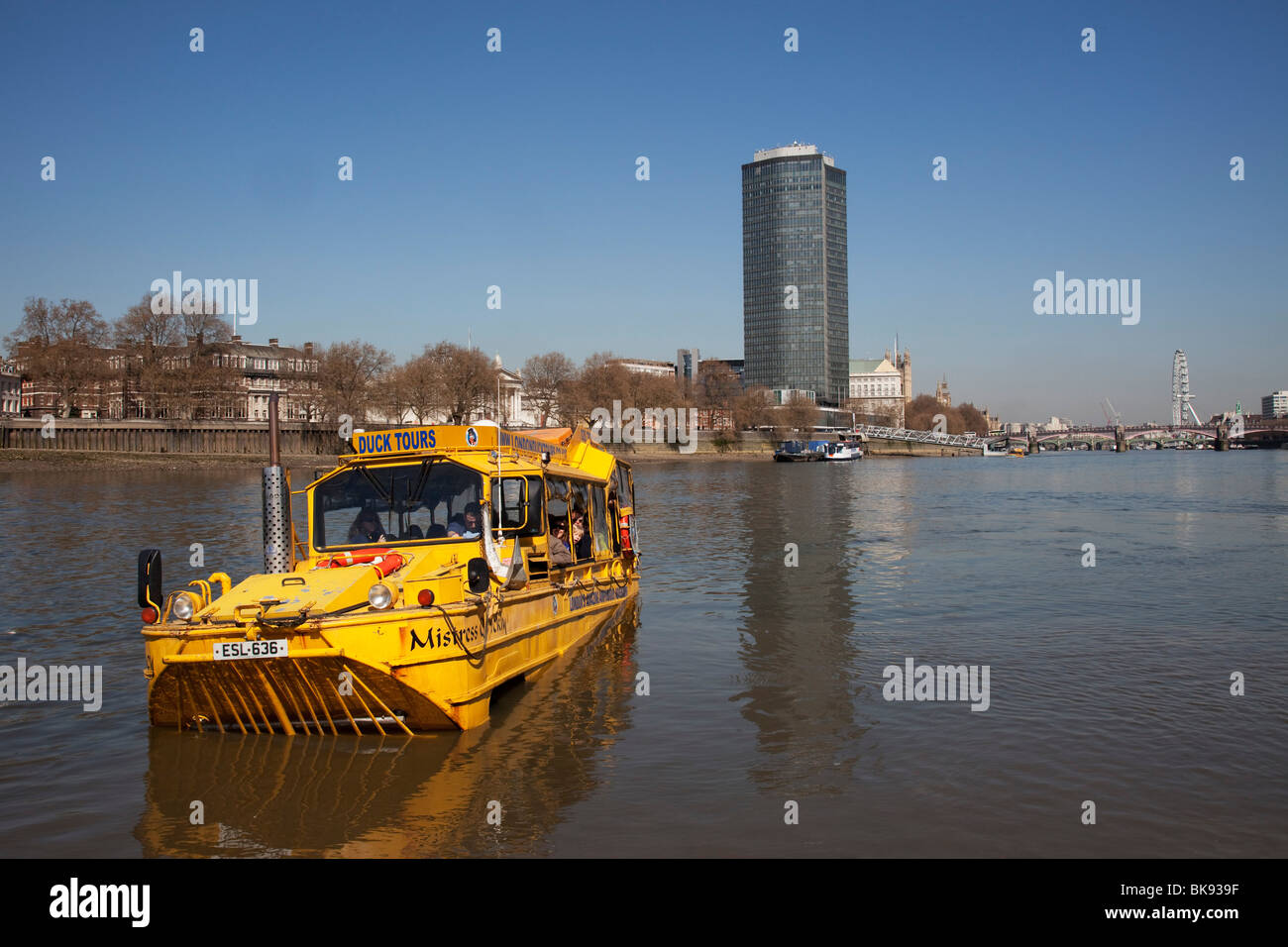 Scene along the River Thames as a Duwk amphibious vehicle drives out of the river onto dry land. The Duck Tours - Stock Image