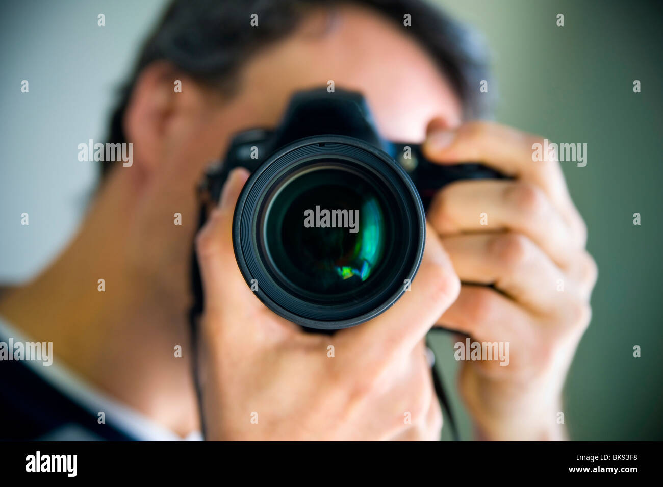 Man taking a picture at the viewer - Stock Image