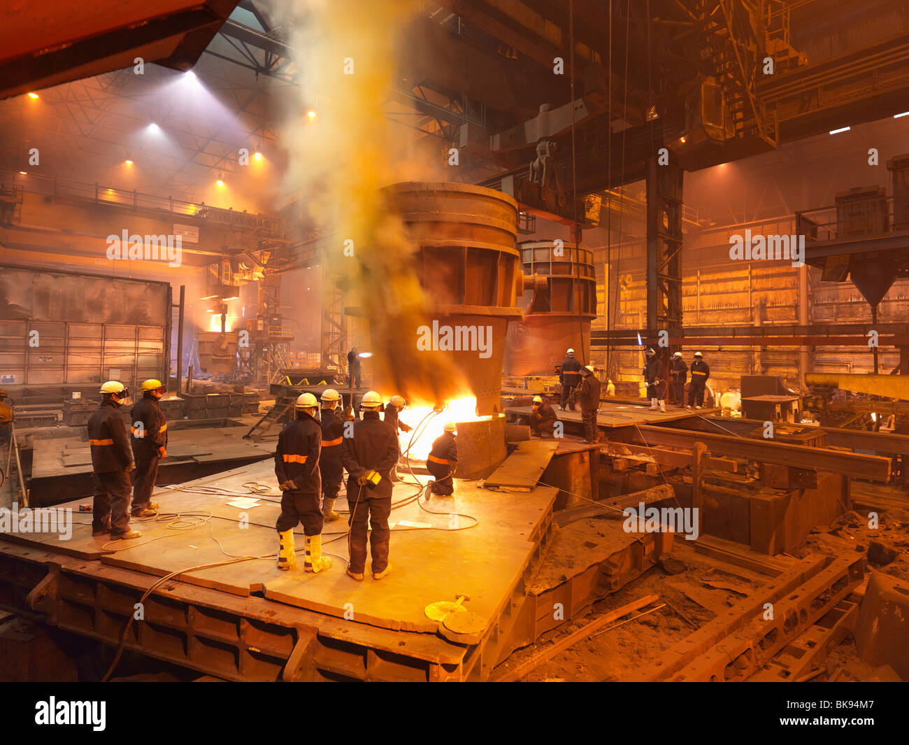Steel Workers In Plant Working On Ladle Stock Photo