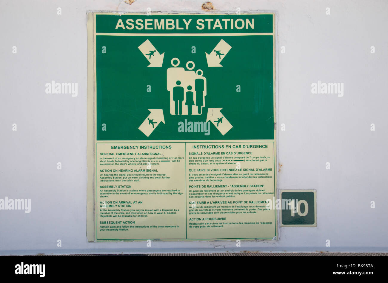 An Assembly Station or Muster Stations meeting sign on the Stena Europe car ferry on the Irish Sea. - Stock Image