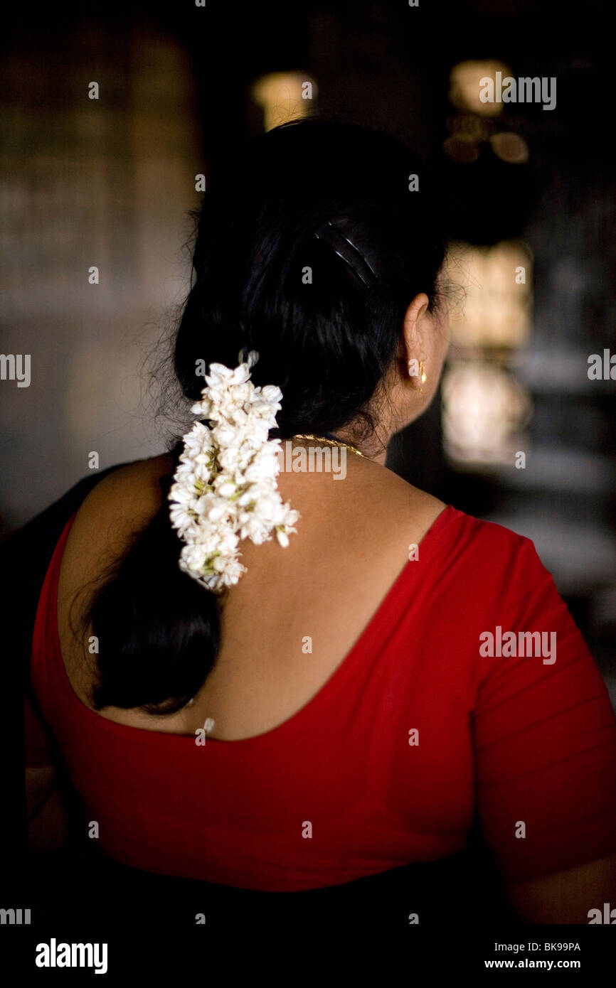 India jasmine hair stock photos india jasmine hair stock images a woman with jasmine flowers in her hair prays at a shrine in the murugan izmirmasajfo