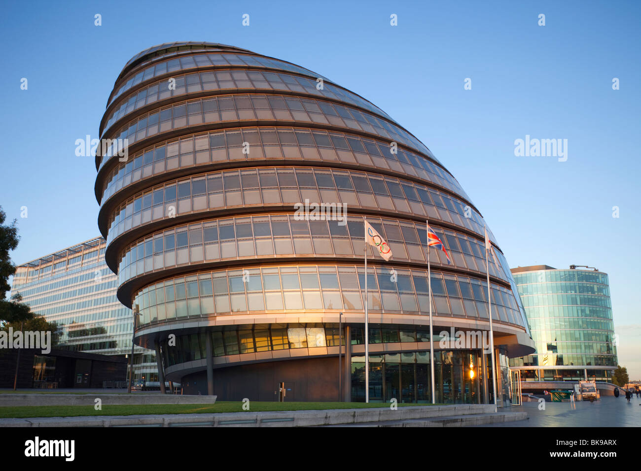 Olympic flag fluttering by the City Hall, Southwark, London, England - Stock Image