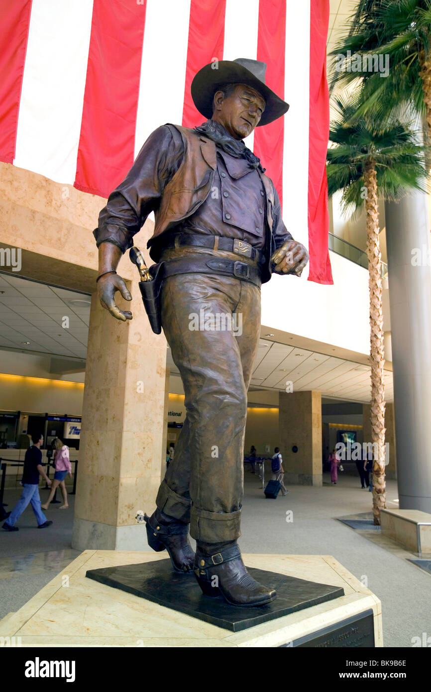 a larger than life statue honors famous film star john wayne at john stock photo 29095206 alamy. Black Bedroom Furniture Sets. Home Design Ideas