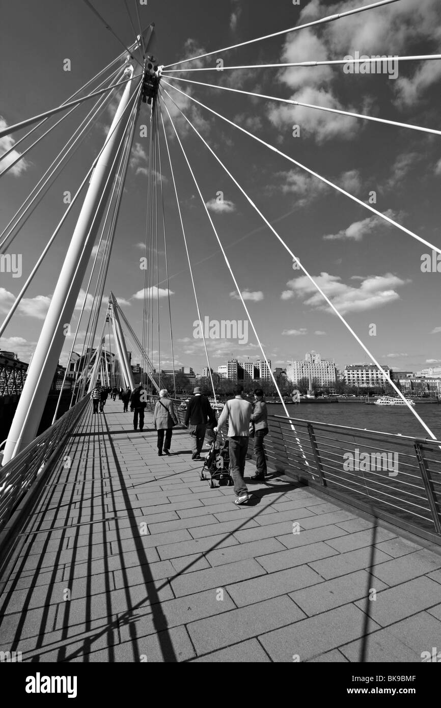 hungerford cable stayed footbridge summer london river thames crossing - Stock Image
