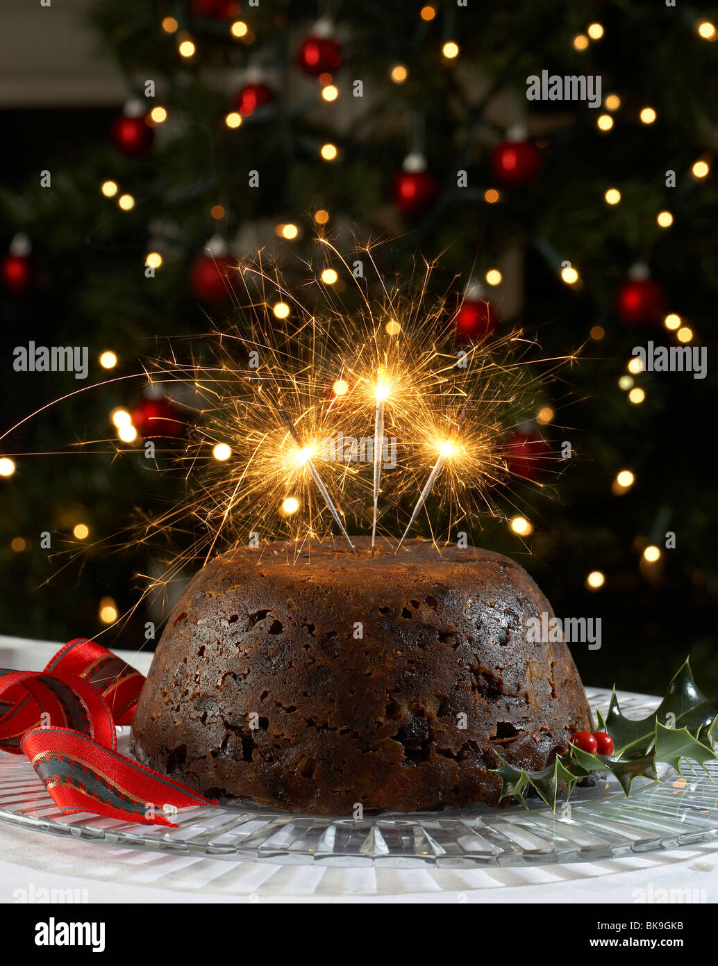 christmas pudding with sparklers - Stock Image