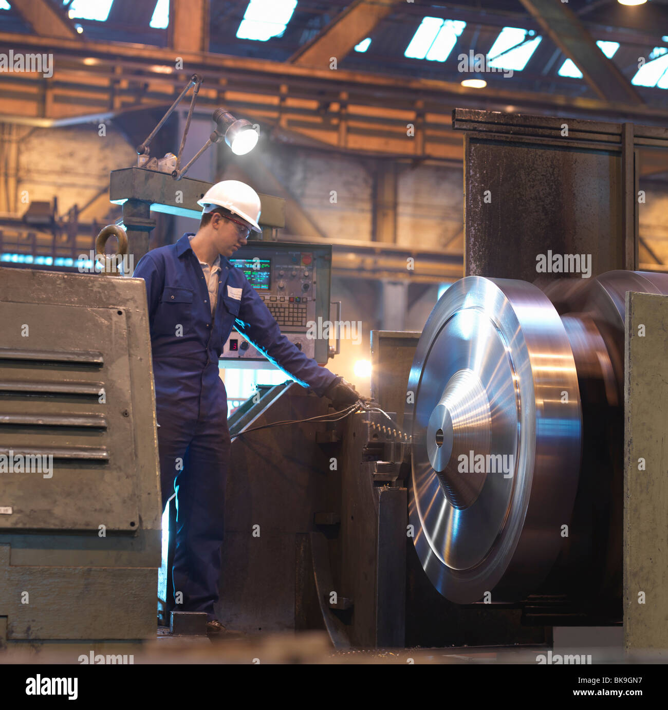 Steel Worker With Lathe - Stock Image
