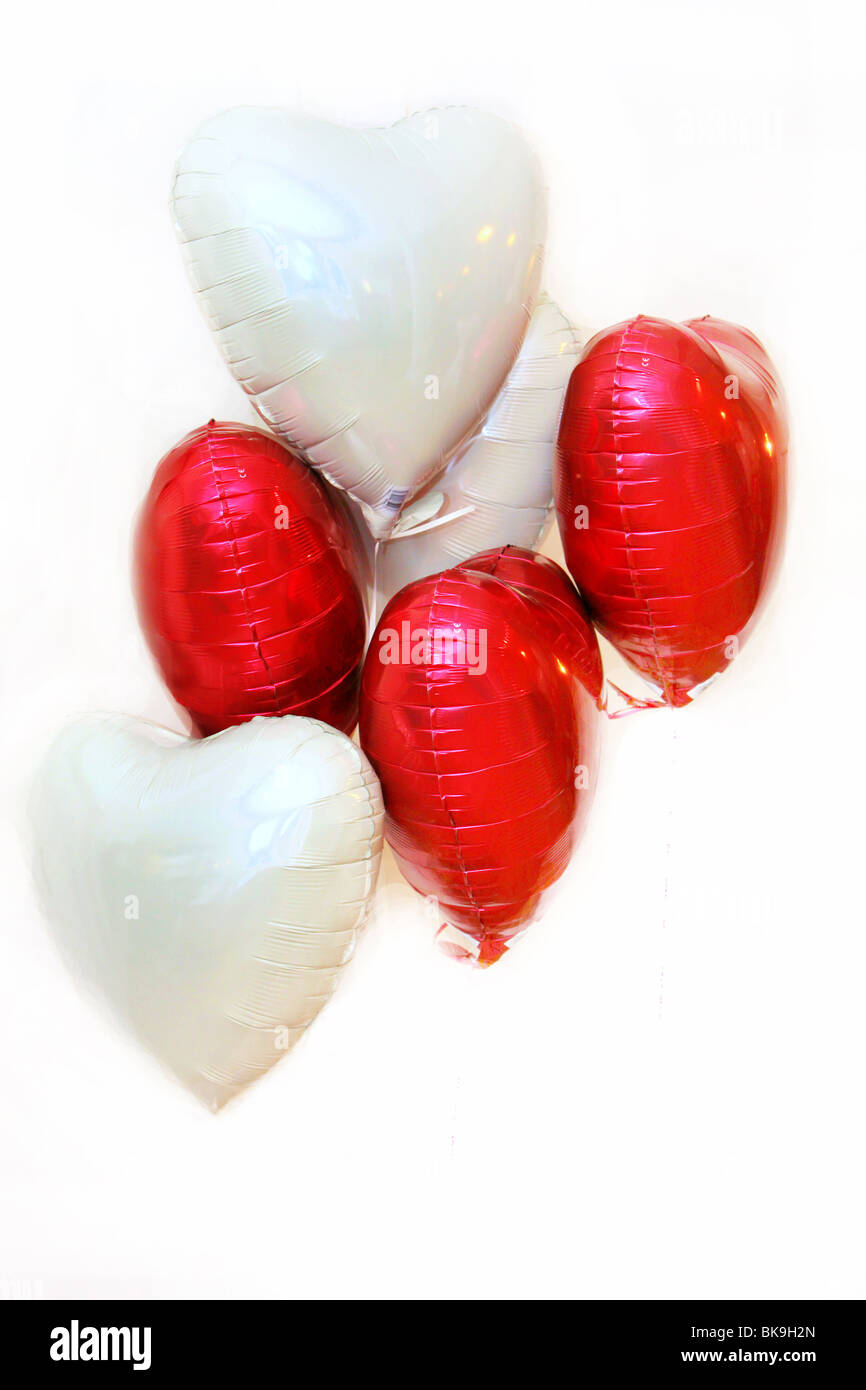 red and white balloons on a white background - Stock Image