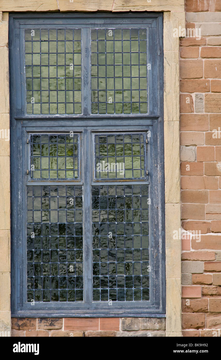 Stone framed leaded windows or a old Abbey - Stock Image