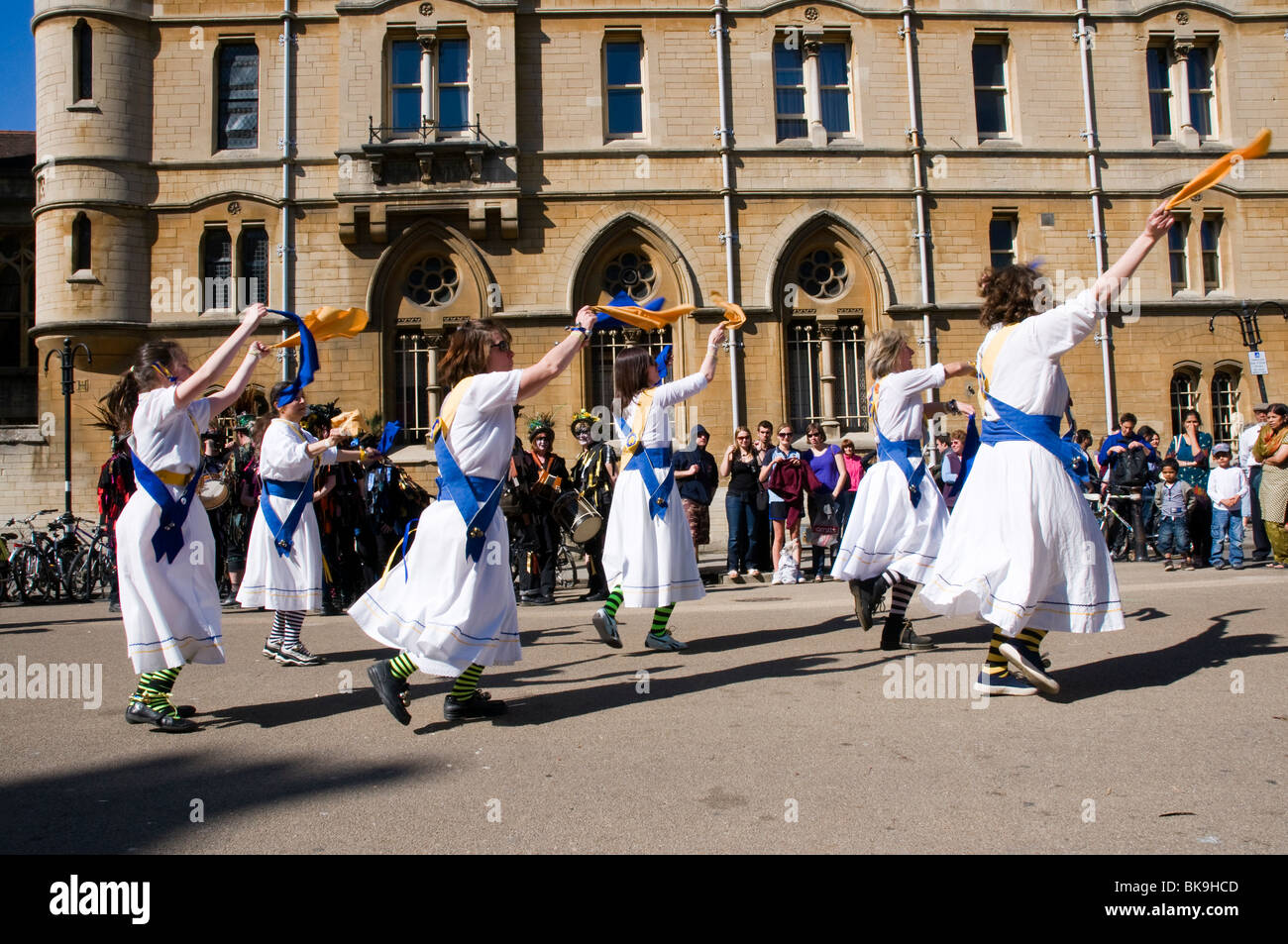 Morris dancers in action at the Oxford Folk Festival, dancing on Broad Street in front of Balliol college. - Stock Image